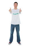 Attractive man wearing volunteer tshirt giving thumbs up Stock Photography