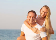 Attractive man and woman at the beach Royalty Free Stock Images