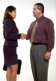 Attractive man and woman business people. Attractive businessman and businesswoman shaking hands Royalty Free Stock Photos