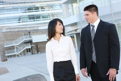 Attractive Man and Woman Business Team Stock Photography