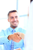 Attractive man and woman business team shaking hands Royalty Free Stock Photos
