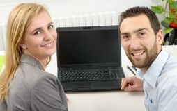 Attractive man and woman business using laptop computer. Attractive men and beautiful women business team using laptop computer Royalty Free Stock Photos