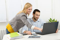 Attractive man and woman business using laptop computer. Attractive men and beautiful women business team using laptop computer Royalty Free Stock Images