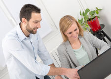 Attractive man and woman business using laptop computer. Attractive men and beautiful women business team using laptop computer Royalty Free Stock Image