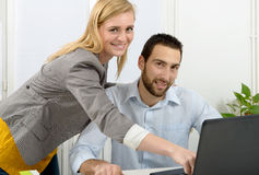 Attractive man and woman business using laptop computer. Attractive men and beautiful women business team using laptop computer Royalty Free Stock Photography