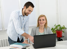 Attractive man and woman business using laptop computer. Attractive men and beautiful women business team using laptop computer Stock Photography