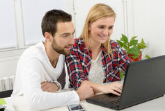 Attractive man and woman business using laptop computer. Attractive men and beautiful women business team using laptop computer Stock Photos