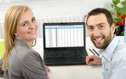 Attractive man and woman business using laptop computer. Attractive men and beautiful women business team using laptop computer Stock Image