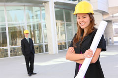 Attractive Man and Woman Construction. Attractive Man and woman architects on a building construction site royalty free stock photography