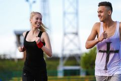 An attractive man and woman jogging Stock Photo