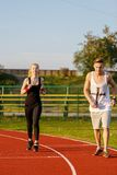 An attractive man and woman jogging Royalty Free Stock Photography