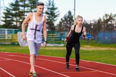 An attractive man and woman jogging Stock Photography