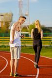 An attractive man and woman jogging Royalty Free Stock Photo