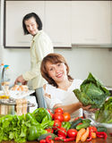 An attractive man and woman with vegetables in the kitchen Stock Photos