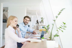 Attractive man and woman are working with joy Royalty Free Stock Photography