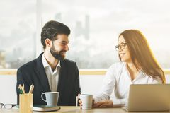 Attractive man and woman working together Stock Photography