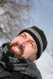 Attractive man with a wool cap and scarf Stock Photos