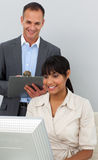 Attractive manager checking his employee's work Stock Photography