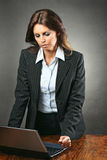 Attractive manager woman angry with the computer Royalty Free Stock Photography