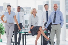 Attractive manger posing with colleagues around Stock Photo