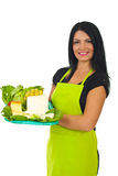 Attractive market worker holding cheese Stock Photos
