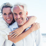 Attractive married couple posing at the beach stock photography
