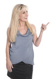 Attractive mature business woman is pointing with forefinger. Royalty Free Stock Image