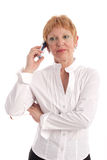 Attractive mature businesswoman. With cell phone stock photos