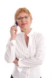 Attractive mature businesswoman. Attractive mature business woman with cell phone Stock Image