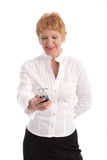 Attractive mature businesswoman. A beautiful mature business woman using cell phone Stock Photos