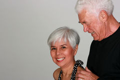 Attractive mature couple. Attractive mature man holding his wife Royalty Free Stock Photography