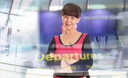 Attractive mature good looking woman portrait. Business concept. London, UK. Attractive mature good looking woman portrait in the airport. Business concept stock image