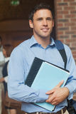 Attractive mature student posing in corridor holding some files Stock Photos
