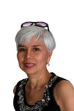 Attractive mature woman. With a pair of sunglasses in her hair stock photography