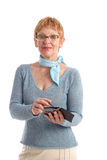 Attractive mature woman. Using handheld Royalty Free Stock Photo