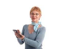 Attractive mature woman. Using handheld stock image