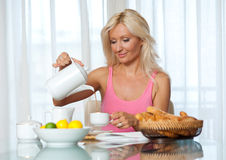 Attractive mature woman at breakfast Royalty Free Stock Photography