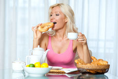 Attractive mature woman at breakfast Royalty Free Stock Photo