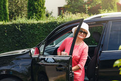 Attractive mature woman in a car Royalty Free Stock Photography