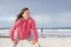 Attractive mature woman exercising at beach Stock Photography