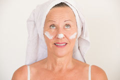 Attractive Mature Woman face lotion Royalty Free Stock Photography