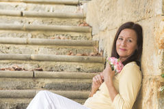 Attractive mature woman in love with rose Royalty Free Stock Photography