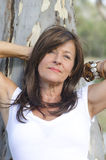 Attractive mature woman relaxed portrait outdoor Royalty Free Stock Photography