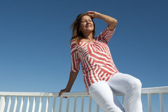 Attractive mature Woman at Seaside Stock Images