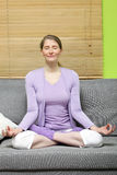 Mature woman meditating Stock Image