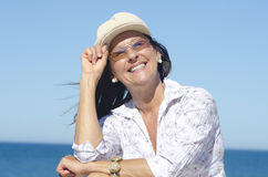 Attractive mature woman sky background Stock Photography