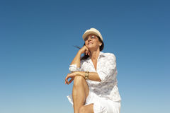 Attractive mature woman sky background Royalty Free Stock Image