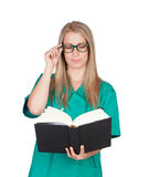 Attractive medical with glasses reading a book Stock Image