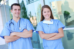 Attractive Medical Team at Hospital. An attractive man and woman medical team at hospital office building Royalty Free Stock Photos