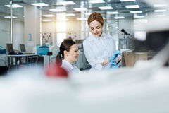 Attractive medical workers being on the background Royalty Free Stock Photos